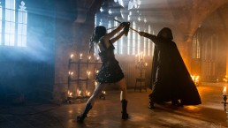 Paul as the Dark Master and Emily in sword training.