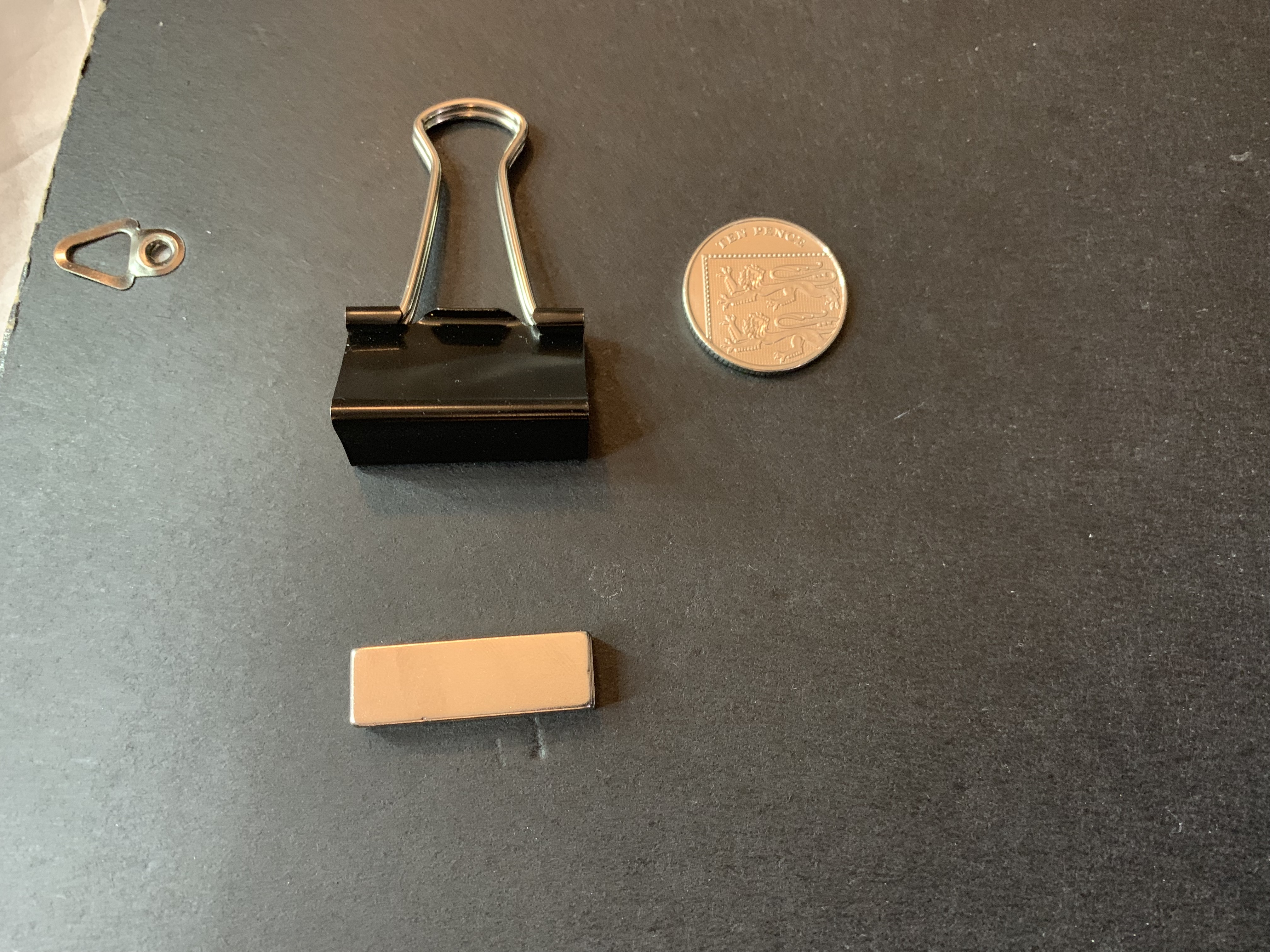 Metal clips and magnets to attach color gels to dishes and modifiers