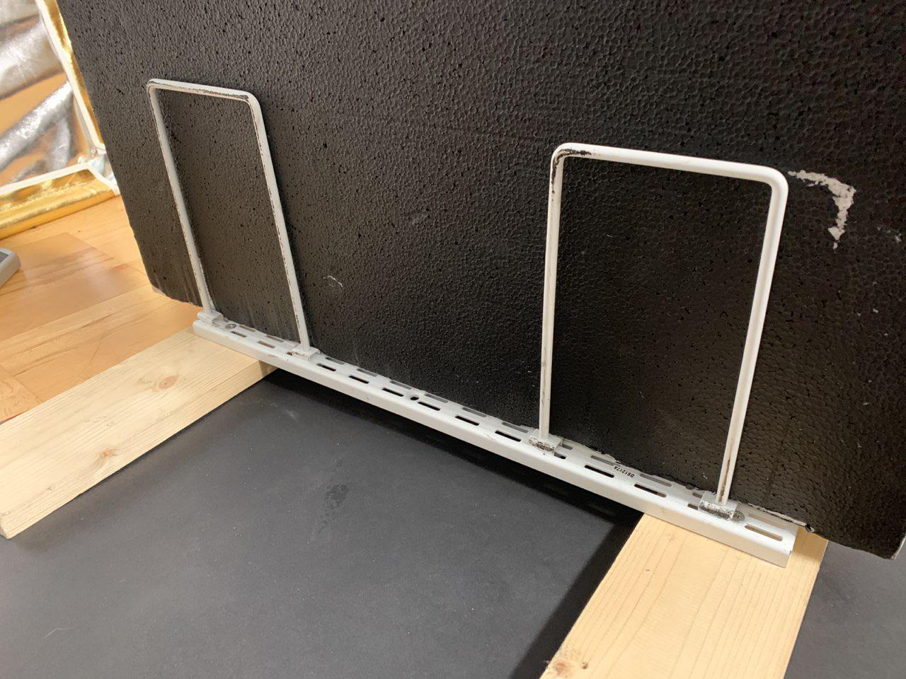 Shelf rails and wood as polyboard stand